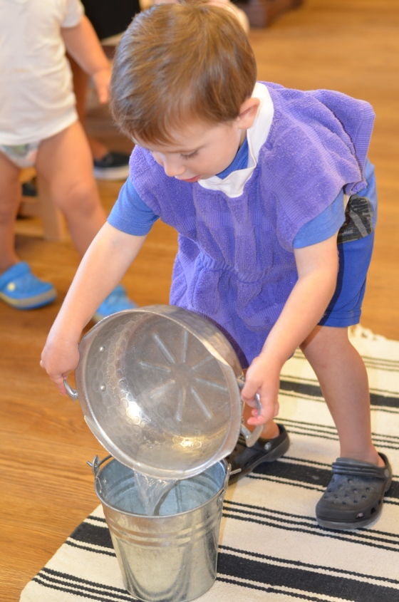 Such concentration is used as he pours the water from the bowl to the bucket, careful not to spill anything on the floor.