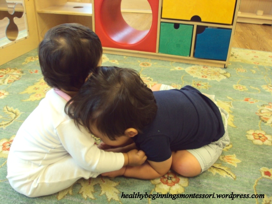 A hug shared between two of our infant community members.