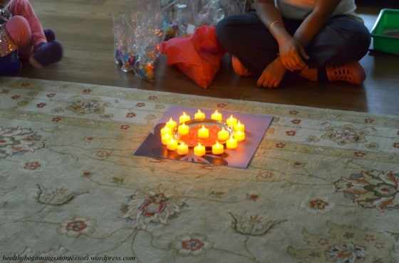 """We lit candles around the rangoli to commemorate the """"Festival of Lights""""."""