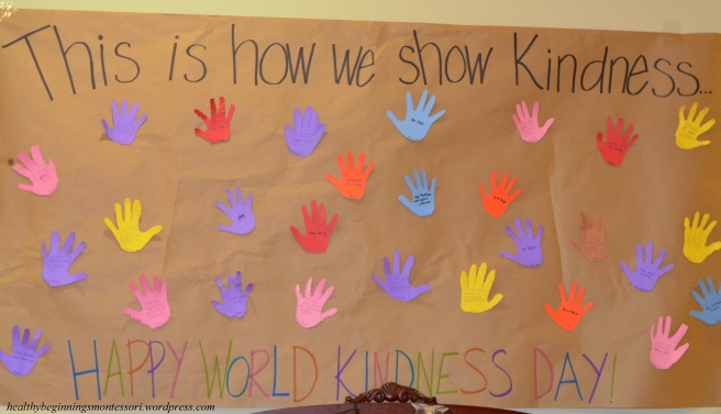 """We made a """"kindness poster"""" describing ways that we can show kindness. Our friends traced their hands and cut, or pin-pricked them out."""