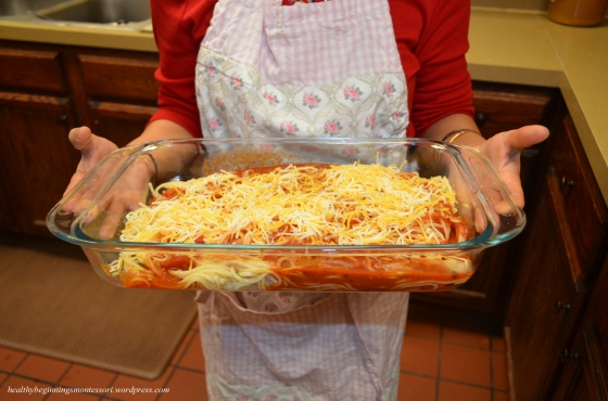 Baked spaghetti topped with shredded mozzarella and cheddar cheeses.